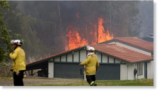 Firefighters battle an out of control bushfire on the Lakes Way, Darawank, near Forster on the NSW mid north coast.