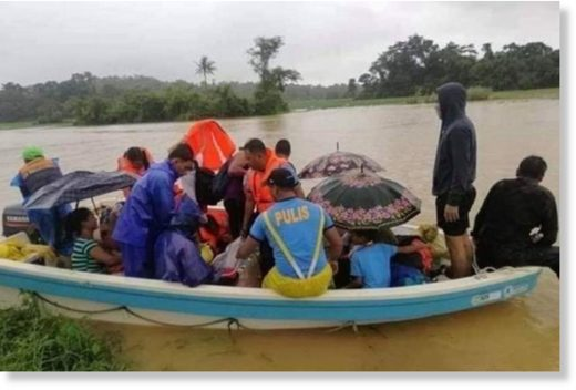 Rescuers help residents displaced