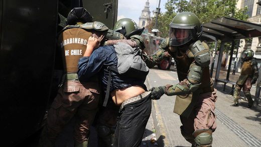 Chilean riot police knock down & drag elderly protester in brutal arrest amid massive anti-neoliberal protests