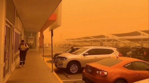 An orange sky is seen as a dust storm blankets Mildura, Victoria, Australia