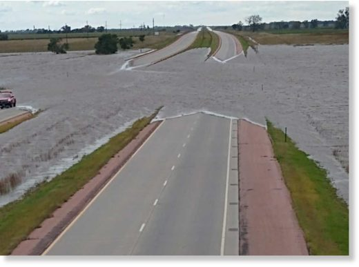 Flood waters run over Interstate 90, two miles west of Mt. Vernon on Thursday, Sept. 12.