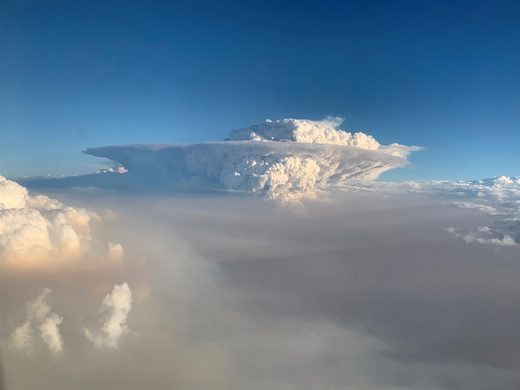 A pyrocumulonimbus cloud formation is seen from a plane as bush fires continue in New South Wales, Australia, on Jan. 4, 2020