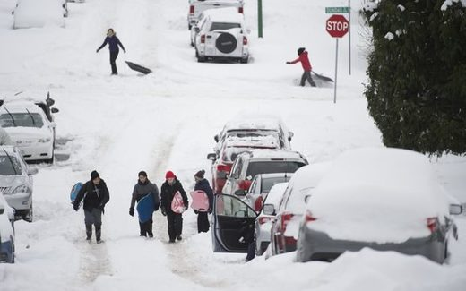 People use the street to slide down following a major snow storm in Burnaby, B.C., on Jan. 15, 2020. Vancouver and the lower mainland have been pounded with heavy snow fall and freezing temperatures