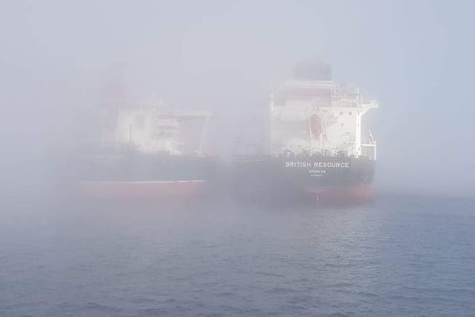 Container ships at Fremantle Port were shrouded in the heavy fog