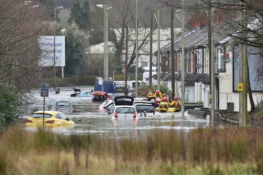 A member of the public is rescued after flooding in Nantgarw, Wales, Sunday, Feb. 16, 2020.