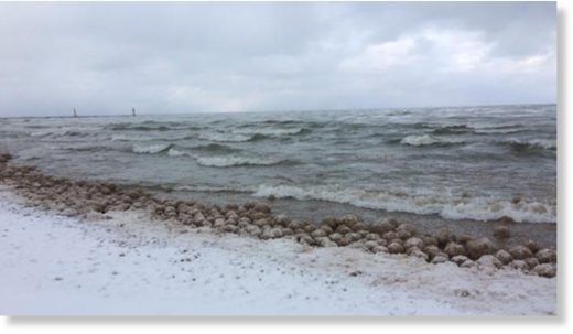 Thousands of ice balls formed and washed along the shore of Lake Michigan on Friday.