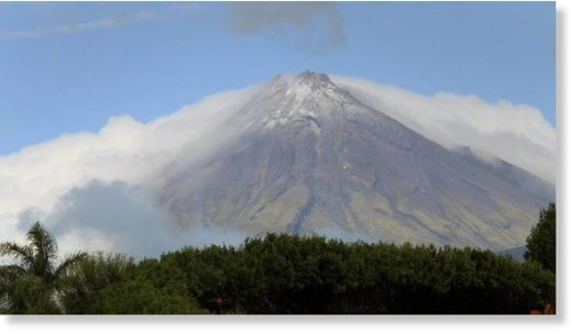 Mount Taranaki was cloaked in cloud and wearing a fresh dusting of snow on Sunday morning.