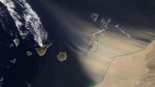 A satellite image shows the sandstorm blasting the Canary Islands from the east