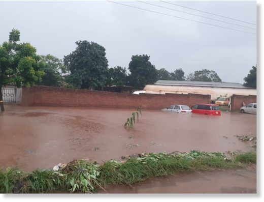 vehicles submerged in water at a garage in Biwi Township and Corporate Mall in Lilongwe