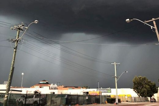 Dark clouds loomed over Morley as the storm front moved across Perth's northern suburbs