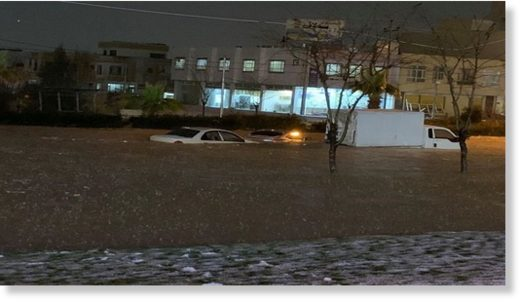 Cars stuck on the street during flash floods in Duhok city, March 18, 2020.