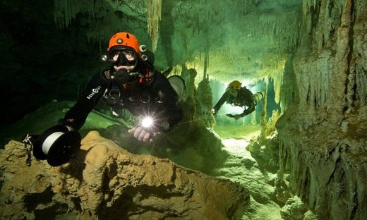 divers underwater cave mexico mayans