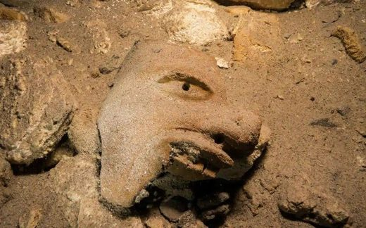 underwater cave mexico mayan mask