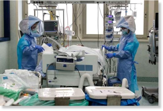 Health care professionals in protective suits