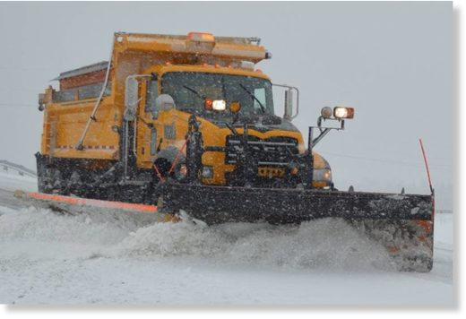 Above, a Nova Scotia Department of Transportation and Infrastructure Renewal plow clears a bridge, located at the top of Upper Prince Street in Sydney, that crosses Highway 125 just south of the Grand Lake Road intersection.