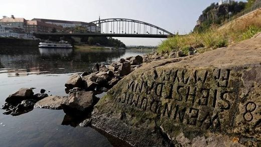 One of the 'hunger stones' revealed by the low level of water in the Elbe River is seen in Decin, Czech Republic, August 29, 2018.