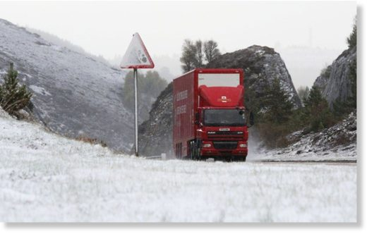 A Royal Mail delivery lorry on the A9 near Inverness where fresh snow has fallen today