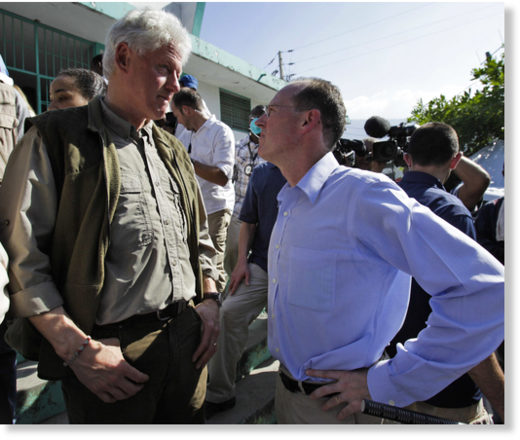 Bill Clinton, left, talks to Dr. Paul Farmer while touring the General Hospital in Port-au-Prince, Jan. 18, 2010.