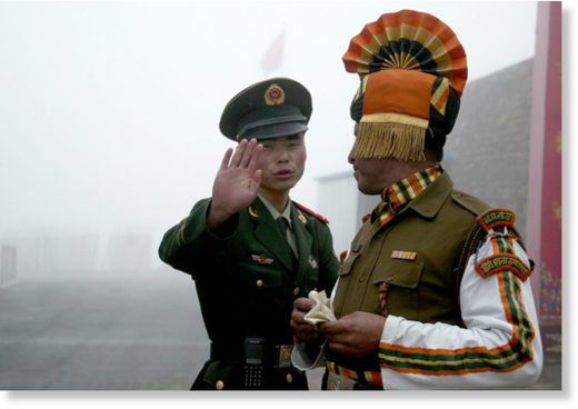 A Chinese soldier (L) next to an Indian soldier at a border crossing in a file photo.