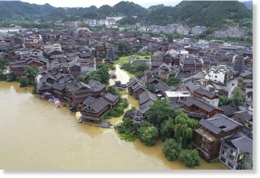 An aerial view of the ancient town of Xiasi during floods in southwest China's Guizhou province on June 23
