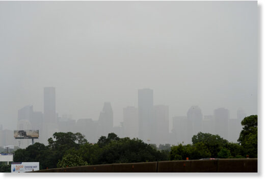 Downtown Houston is cloaked in haze as a Saharan dust cloud moves over parts of Texas on Friday, June 26, 2020.