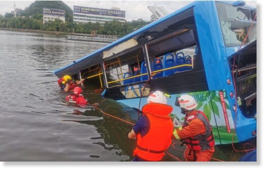 Rescue workers are seen at the site where a bus carrying students plunged into a lake