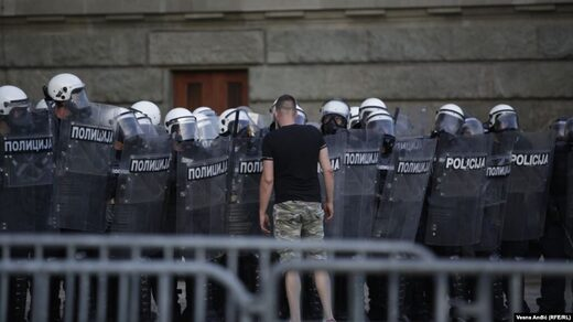 protester faces police Belgrade Serbia