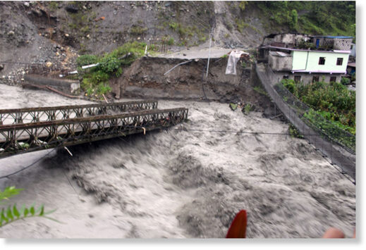 Rainfall-triggered flood damages a bridge at Raghuganga River in Myagdi district.