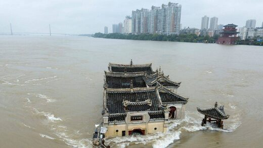 The Kwanyin temple built on a rocky island in the middle of the Yangtze River is seen flooded as the water level surge along Ezhou in central China's Hubei province