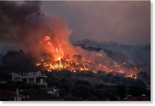 Fire burns near the village of Galataki as authorities evacuate the place near Corinth, Greece. July 22, 2020