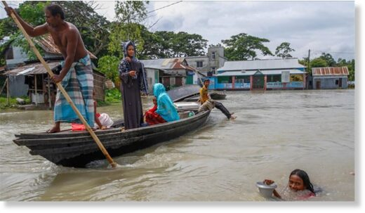 People ride on boat in flooded area after heavy monsoon rains in Dohar near Dhaka, Bangladesh on July 24, 2020.