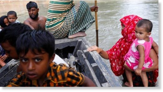 Flood-affected people get on a boat