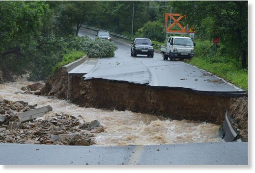 Collapsed road due to heavy rain in Chungju on August 2.
