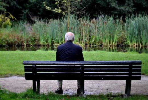 old man on bench loneliness alzheimer's