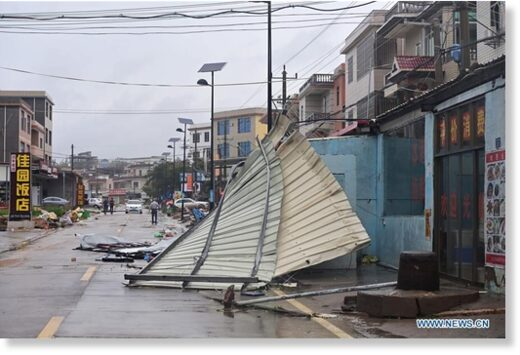 Advertisement boards are blown down by strong winds brought by Typhoon Mekkhala in Qianting Town of Zhangpu County, Zhangzhou, southeast China's Fujian Province, Aug. 11, 2020.