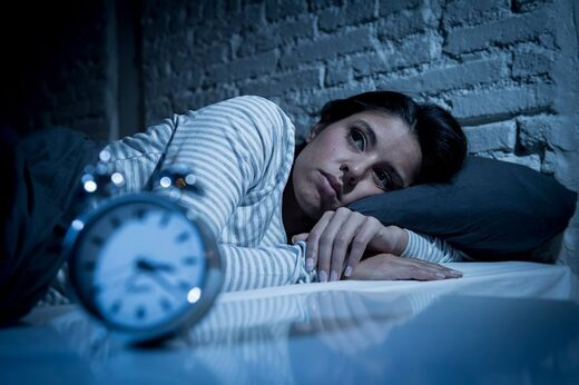 Woman lying awake insomnia