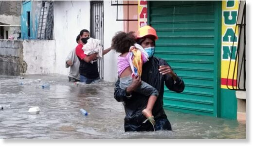 Volunteers from Dominican Republic Red Cross carry out evacuations after floods from Tropical Storm Laura, August 2020.