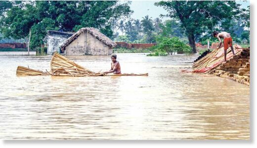 Residents shift from a flooded village near the banks of river Bhargavi in Odisha's Khordha district on Saturday.