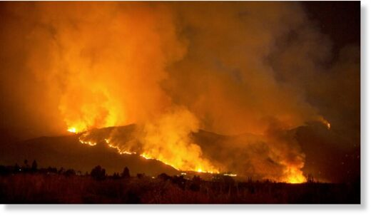 A wildfire burns in Yucaipa, California.
