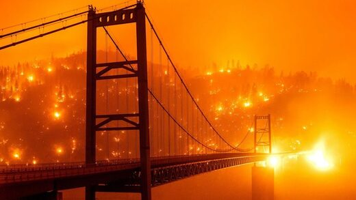 Fires light up a hillside behind the Bidwell Bar Bridge in Oroville, California