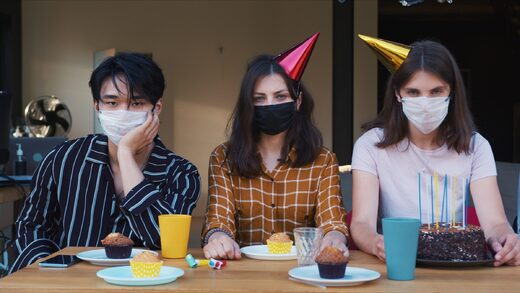students wearing mask at party