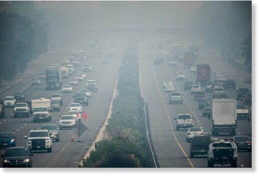 Vehicles on Interstate 80 in Vacaville drive through smoke from California's wildfires on Monday, Aug. 24, 2020.