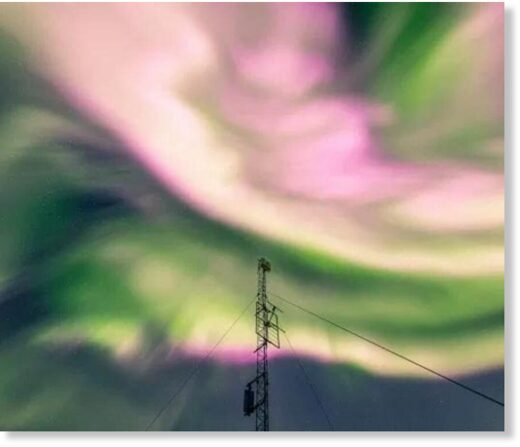 The northern lights appear pink over Tromso, Norway, on Saturday night.