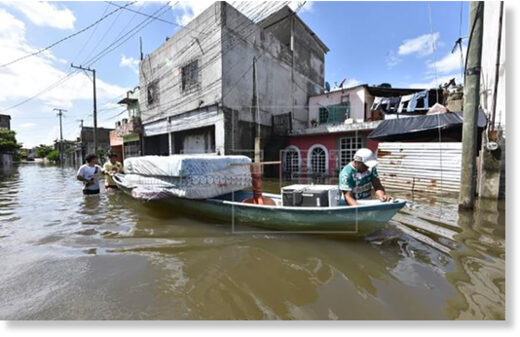 Flood victims salvage their belongings from flooded homes in Tabasco.