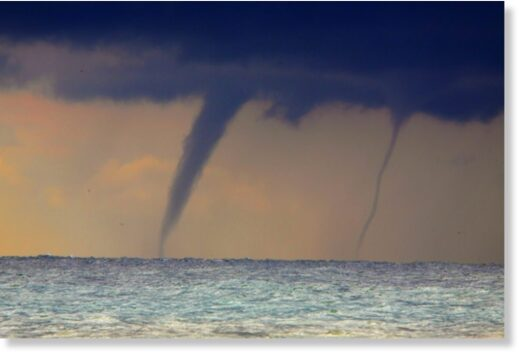 Waterspouts over open water.