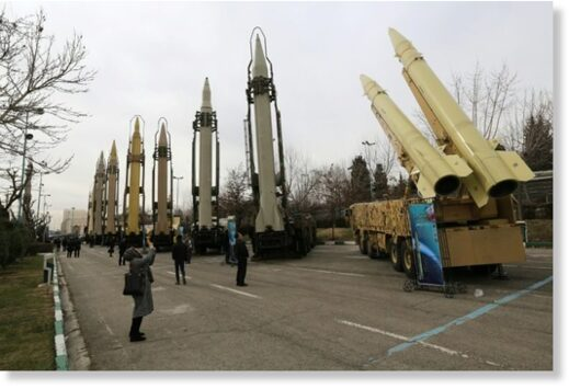 Iranians visiting a weaponry and military equipment exhibition