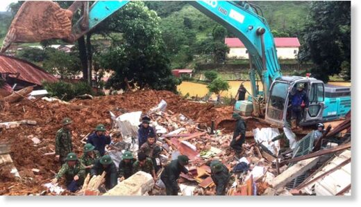 This picture taken on October 18, 2020 and released by the Vietnam News Agency on October 18, 2020 shows military personnel searching for missing soldiers at the site of a landslide in central Vietnam's Quang Tri province.