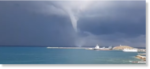A waterspout, or sea tornado, forming above the Greek island of Naxos.
