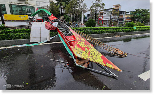 A welcome gate on Le Loi Street in Quang Ngai Province is fallen following strong winds due to Storm Molave, October 28, 2020.
