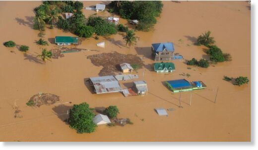 Houses are submerged in flooded areas in Cagayan valley region, northern Philippines on November 14, 2020.